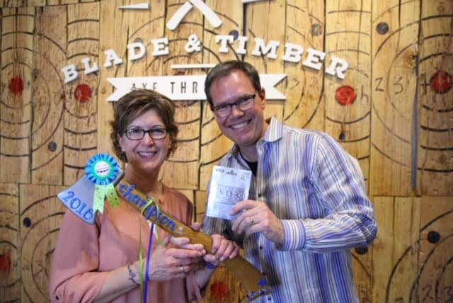 Shellie-and-Dr-winner-Ax-throwing  - Braces and Invisalign in Kansas City, Overland Park, Olathe, and Paola, Kansas - Oltjen Orthodontics